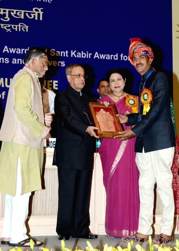 President Pranab Mukherjee with Union Minister of State (Independent Charge) Textiles Santosh Kumar Gangwar during a programme organised to confer National Awards, Shilp Guru Awards and Sant Kabir ... - Pranab Mukherjee and Santosh Kumar Gangwar