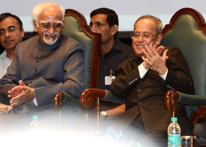 President Pranab Mukherjee with Vice-President Mohammad Hamid Ansari during the presentation ceremony of the Outstanding Parliamentarian Awards for the years 2010, 2011 and 2012, at Balayogi ... - Pranab Mukherjee