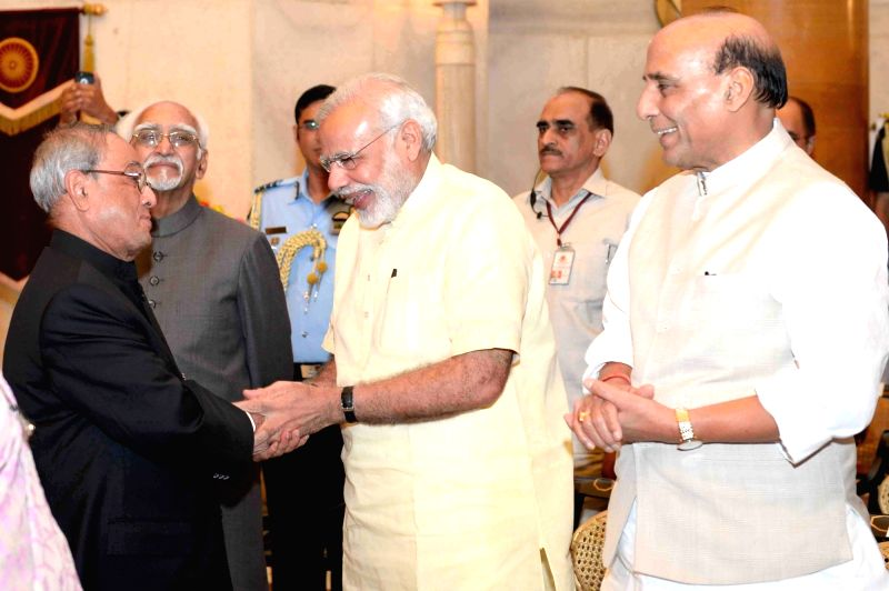 President Pranab Mukherjee with Vice-President Mohammad Hamid Ansari, Prime Minister Narendra Modi and Union Home Minister Rajnath Singh during a reception hosted by him  for Freedom ... - Narendra Modi, Pranab Mukherjee and Rajnath Singh