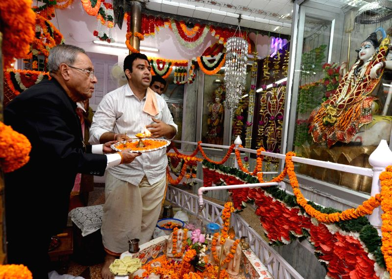 President Pranab Mukherjee worships lord Shiva during his visit to Shiv Mandir located inside the President's Estate on Janmashtami in New Delhi on Aug 18, 2014. - Pranab Mukherjee