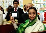 President Pratibha Patil displays the winning entry of a logo competition for Roshini, the green initiative she has launched in Rashtrapati Bhawan - Pratibha Patil