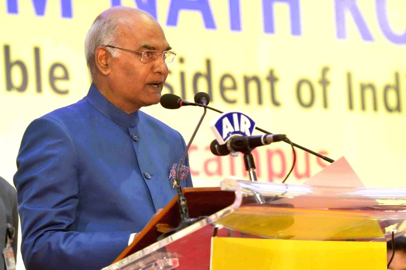 President Ram Nath Kovind addresses after unveiling the plaque to lay the foundation stone of the E-Classroom Complex and Incubation Centre in Visakhapatnam, Andhra Pradesh on Dec 7, ... - Nath Kovind