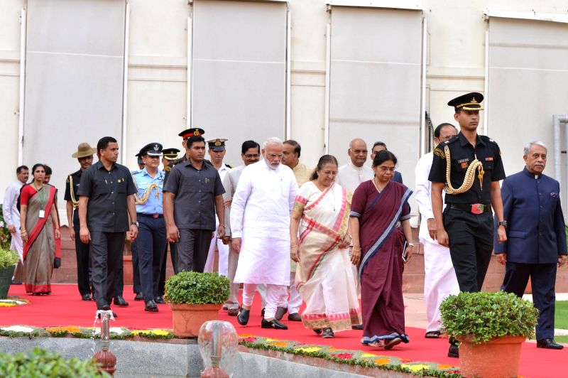 President Ram Nath Kovind and Vice-President M. Venkaiah Naidu being escorted by Lok Sabha Speaker Sumitra Mahajan and Prime Minister Narendra Modi to the Central Hall of Parliament for ... - Sumitra Mahajan, M. Venkaiah Naidu, Narendra Modi and Nath Kovind