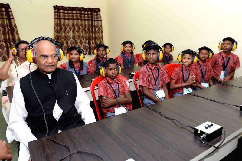 President Ram Nath Kovind during his visit to Saksham School in Shri Atal Bihari Vajpayee Education City premises at Jawanga in Dantewada district of Chhattisgarh on July 25, 2018. - Nath Kovind