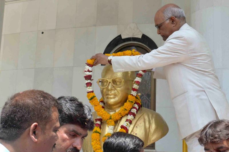 President Ram Nath Kovind garlands the statue of Dr. B.R. Ambedkar on his 127th birth anniversary, at his memorial in Mhow, Madhya Pradesh on April 14, 2018. - Nath Kovind