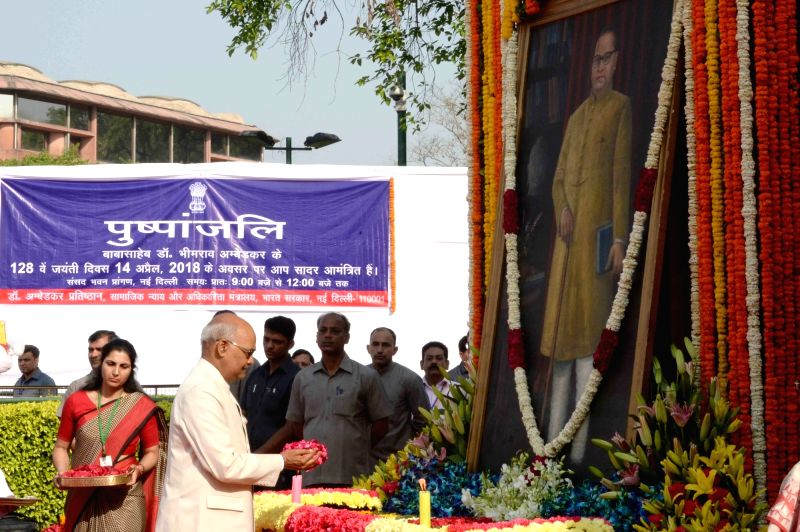 President Ram Nath Kovind pays tributes to Dr. B.R. Ambedkar on his 127th birth anniversary, at Parliament House in New Delhi on April 14, 2018. - Nath Kovind