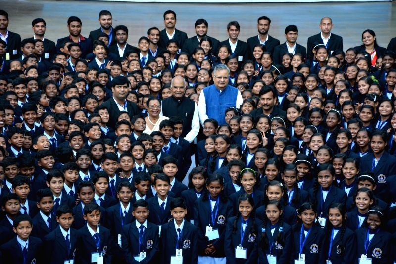 President Ram Nath Kovind pose for group photo with Aastha Vidya Mandir's students at Jawanga in Dantewada district of Chhattisgarh on July 25, 2018. Also seen Chhattisgarh Chief Minister ... - Raman Singh and Nath Kovind