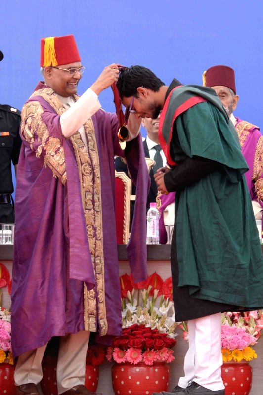 President Ram Nath Kovind presents a medal to a student during the convocation of Aligarh Muslim University on March 7, 2018. - Nath Kovind