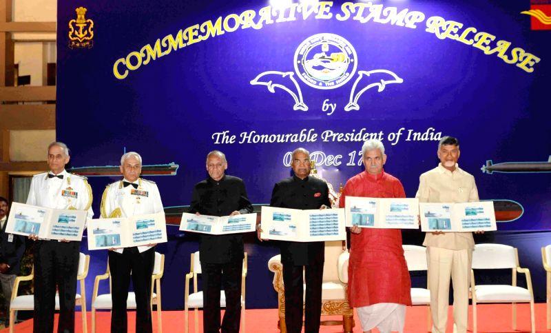 President Ram Nath Kovind releases the commemorative stamp on INS Kalvari at ENCO Mess Lawns, INS Dega, in Visakhapatnam, Andhra Pradesh on Dec 7, 2017. Also seen Andhra Pradesh and ... - N Chandrababu Naidu, Nath Kovind and Manoj Sinha