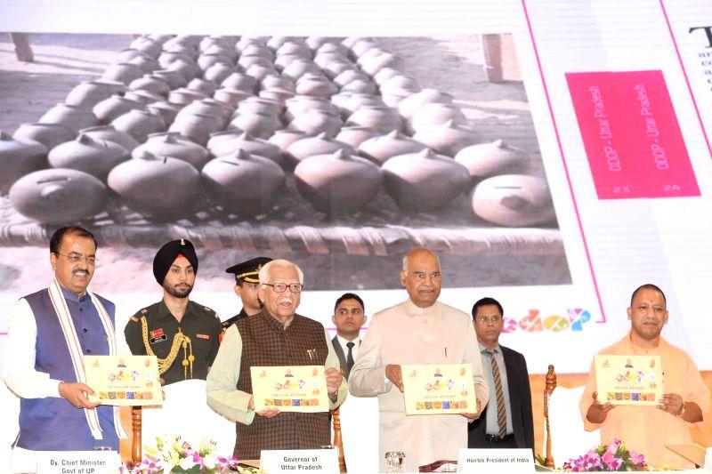 President Ram Nath Kovind, Uttar Pradesh Governor Ram Naik, Chief Minister Yogi Adityanath and Deputy Chief Minister Keshav Prasad Maurya at the inauguration of 'One District, One Product' ... - Yogi Adityanath and Nath Kovind