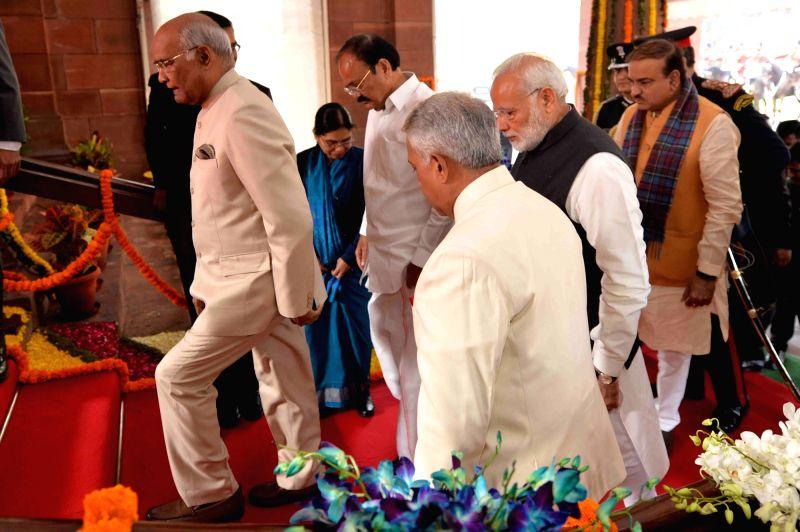 President Ram Nath Kovind, Vice President M. Venkaiah Naidu, Prime Minister Narendra Modi and Union Minister Ananth Kumar walk towards the central hall of Parliament House for President's ... - Narendra Modi, M. Venkaiah Naidu, Nath Kovind and Ananth Kumar