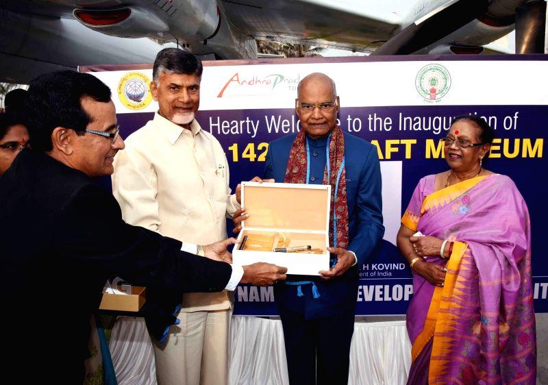 President Ram Nath Kovind with Andhra Governor E. S. L. Narasimhan and Chief Minister N. Chandrababu Naidu during inauguration of TU 142M Aircraft Museum was laid at Ramakrishna Beach ... - N. Chandrababu Naidu and Nath Kovind
