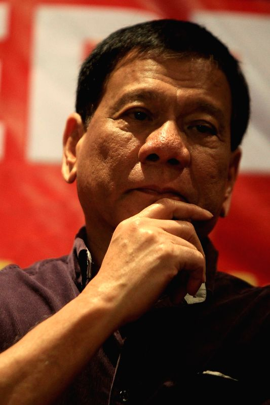 Presidential candidate and current Davao City Mayor Rodrigo Duterte speaks during his proclamation rally in Manila, the Philippines, Nov. 30, 2015. Duterte ...