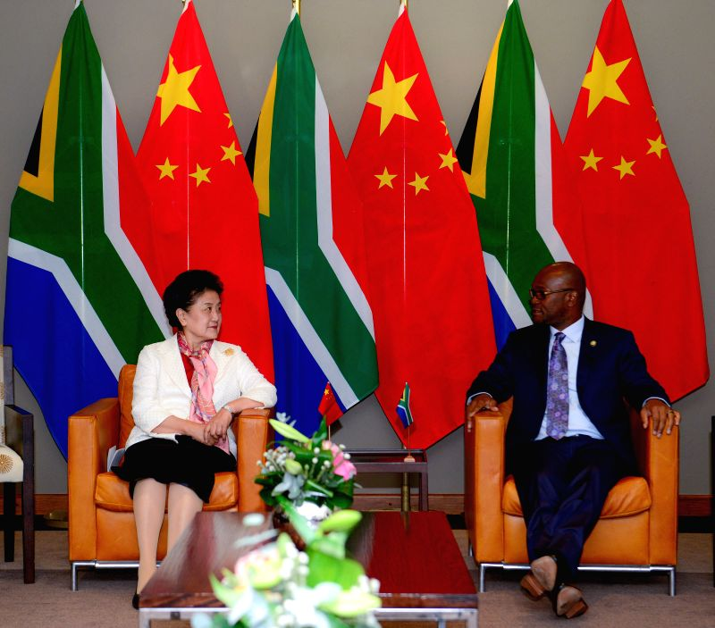 PRETORIA, April 24, 2017 - Chinese Vice Premier Liu Yandong (L) meets with South African Minister of Arts and Culture Nathi Mthethwa in Pretoria, South Africa, on April 24, 2017. China stands ready ...