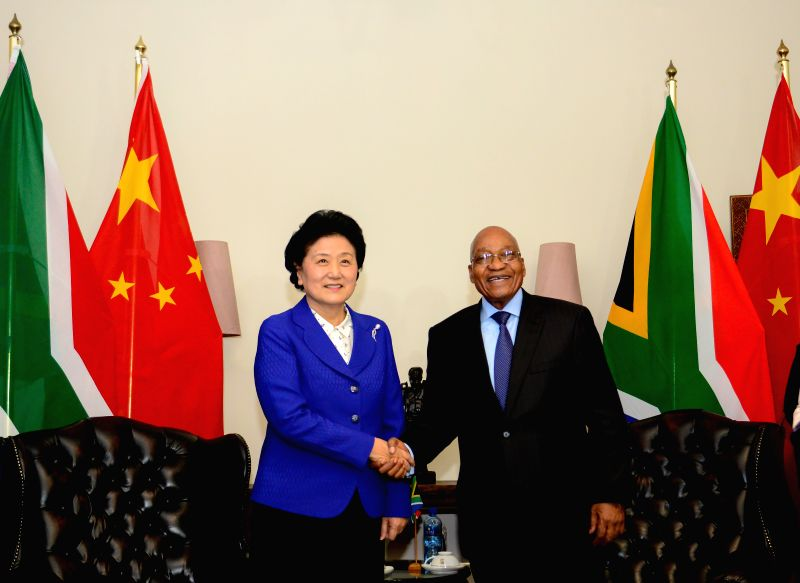 PRETORIA, April 26, 2017 - Chinese Vice Premier Liu Yandong (L) shakes hands with South African President Jacob Zuma in Pretoria, South Africa, April 25, 2017. Zuma on Tuesday hailed China's ...