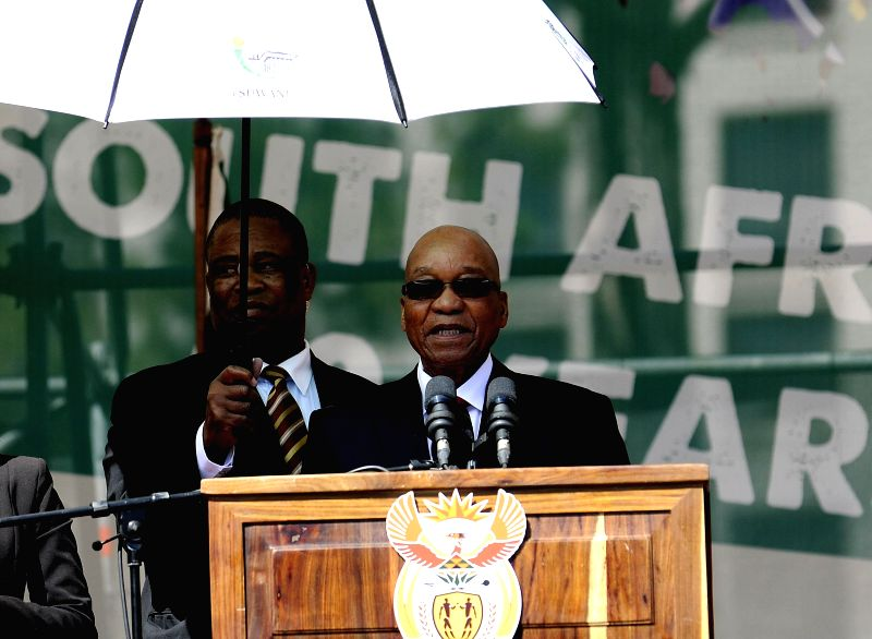 South African President Jacob Zuma (R) speaks during a celebration to commemorate the Freedom Day in Pretoria, South Africa, on April 27, 2014. The Freedom Day is