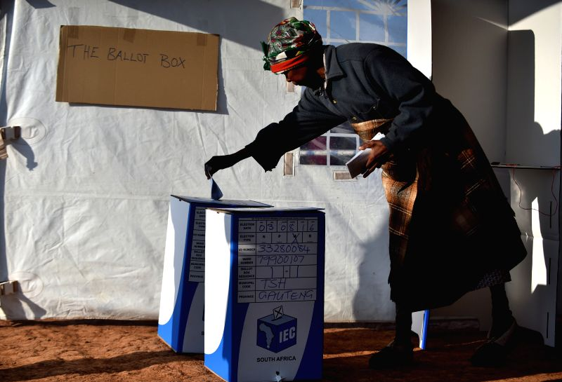 PRETORIA, Aug. 3, 2016 - A woman casts her vote at a polling station in Atteridgeville, Pretoria, South Africa, on Aug. 3, 2016. The 2016 municipal elections kicked off on Wednesday, with polling ...