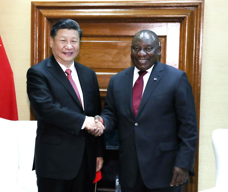 PRETORIA, July 24, 2018 - Chinese President Xi Jinping (L) and his South African counterpart Cyril Ramaphosa hold talks in Pretoria, South Africa, July 24, 2018.