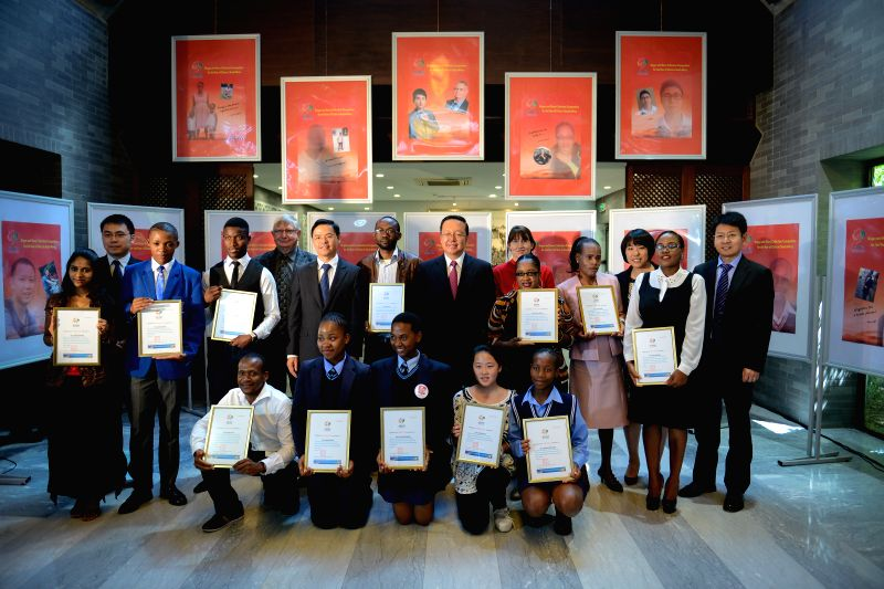 Chinese Ambassador to South Africa, Tian Xuejun (C) poses for a group photo with winners of the slogan and story collection competition for the Year of China in ...