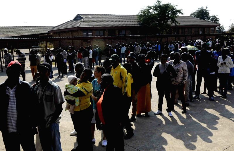 Voters queue up outside a polling station in Pretoria, South Africa, May 7, 2014. South Africa on Wednesday kicked off its general election which is the first one ...