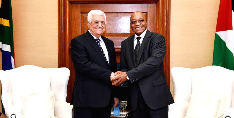 Pretoria (South Africa): South Africa's President Jacob Zuma (R) shakes hands with visiting Palestinian President Mahmoud Abbas on his State visit to South Africa at the Union Buildings, Pretoria, ...