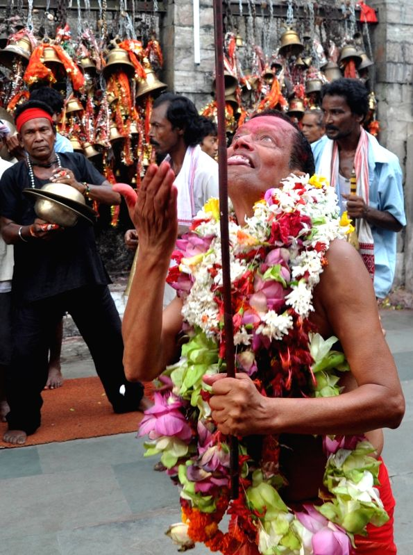 Priests dance during the Deodhani Festival at the Kamakhya Temple in Guwahati on Aug 18, 2016.