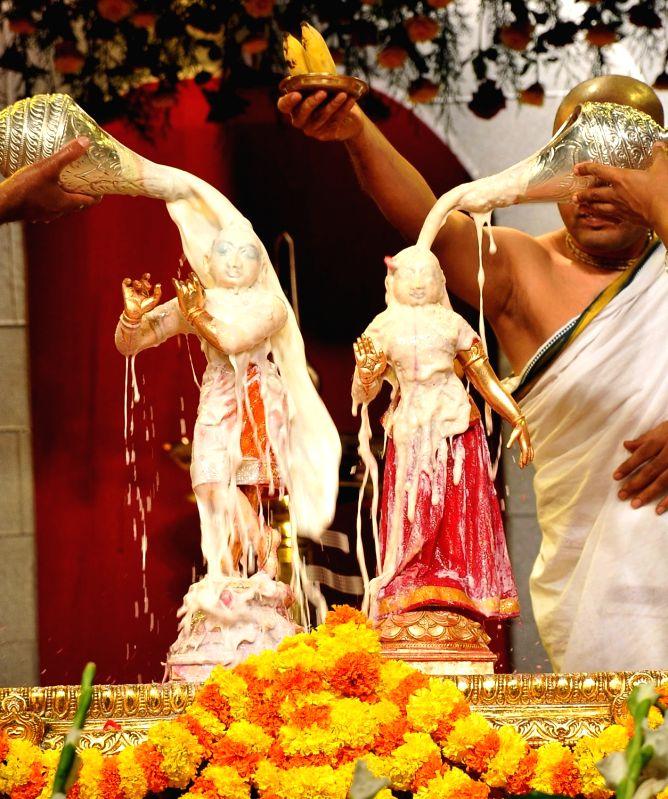 Priests perform rituals during Janmashtami celebrations