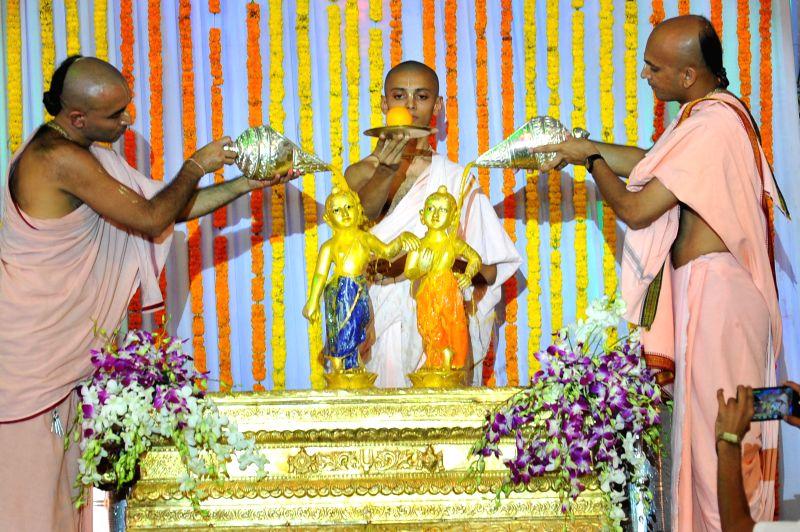 Priests worship lord Krishna at Krishna Balaram Temple at Akshaya Patra on Janmashtami in Jaipur on Aug 18, 2014.