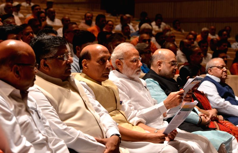 Prime Minister and BJP leader Narendra Modi being welcomed by party leaders during BJP Parliamentary meeting, in New Delhi, on Aug 7, 2018. - Narendra Modi