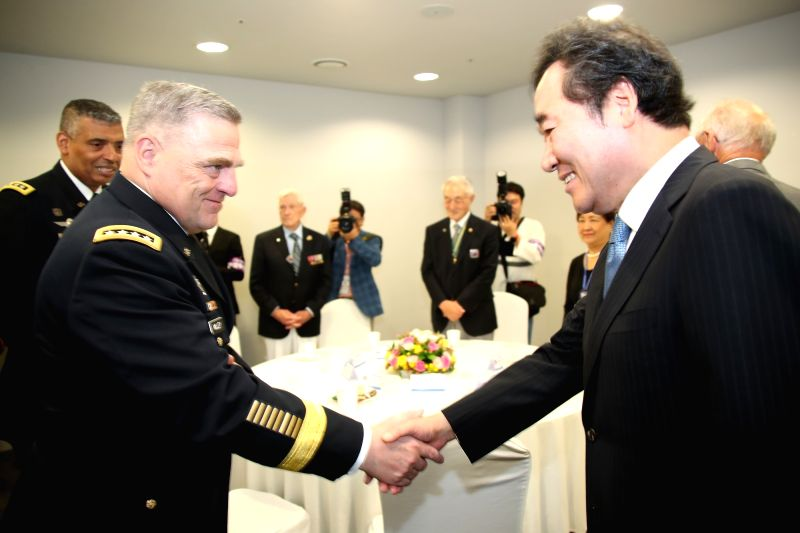 Prime Minister Lee Nak-yon (R) meets Gen. Mark Milley, U.S. Army chief of staff, in Seoul on July 27, 2018, at a ceremony marking U.N. Forces Participation Day. The day was designated to honor ... - Lee Nak