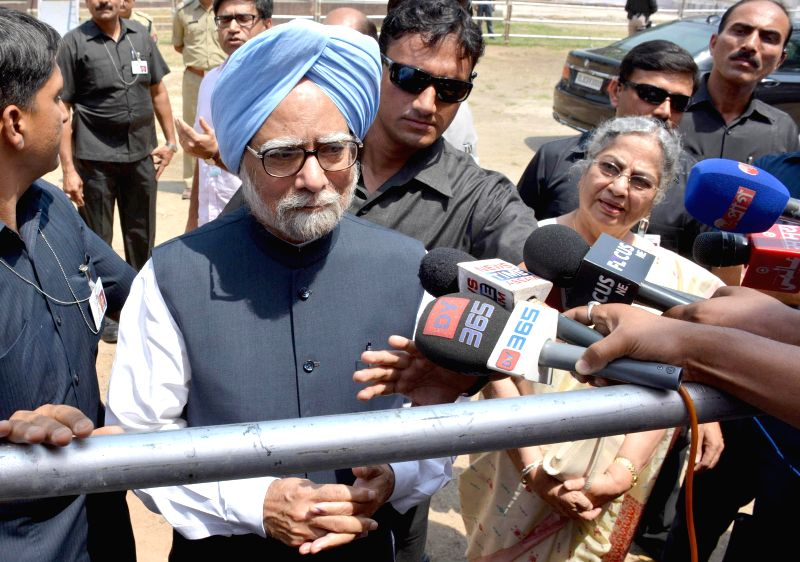 Prime Minister Manmohan Singh addresses press after casting his vote during at a  polling booth during the sixth phase of 2014 Lok Sabha Polls in Guwahati on April 24, 2014.