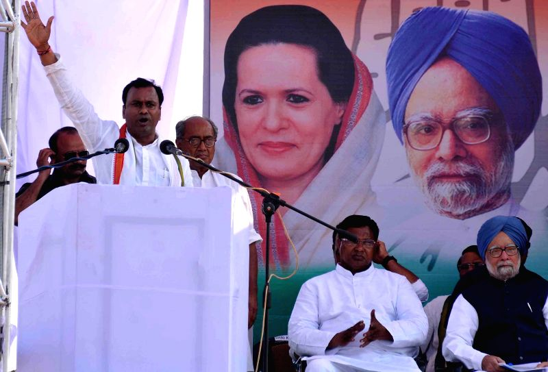 Prime Minister Manmohan Singh addressing a public meeting with Congress candidates at Bhoongir in Nalgunda district of Andhra Pradesh on April 26, 2014.