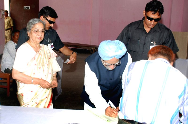 Prime Minister Manmohan Singh and his wife Gursharan Kaur arrive at a polling booth to casts their votes during the sixth phase of 2014 Lok Sabha Polls in Guwahati on April 24, 2014. - Gursharan Kaur
