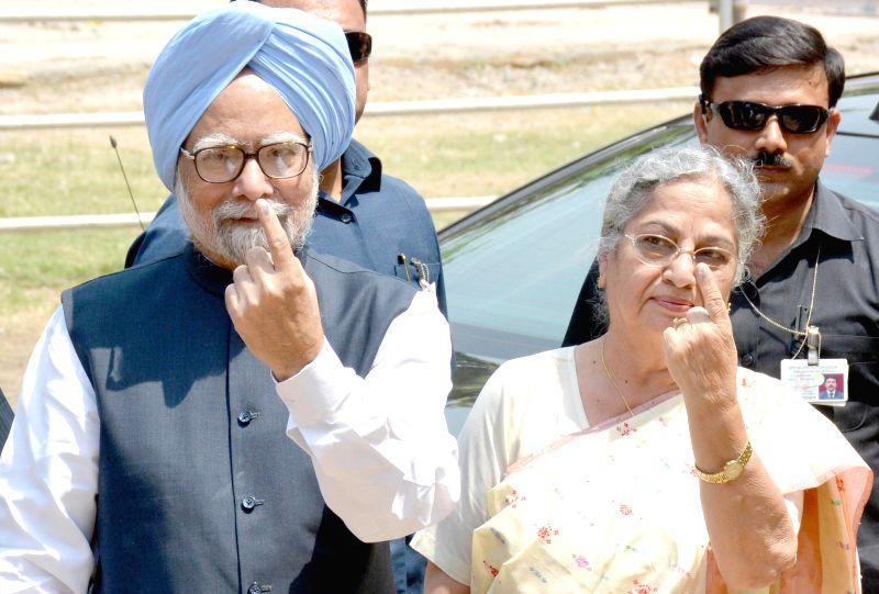 Prime Minister Manmohan Singh and his wife Gursharan Kaur . (File Photo: IANS)