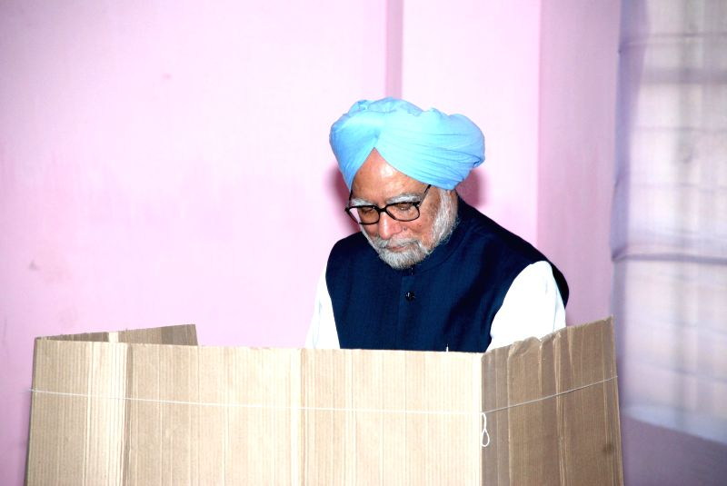Prime Minister Manmohan Singh casts his vote at a polling booth during the sixth phase of 2014 Lok Sabha Polls in Guwahati on April 24, 2014.