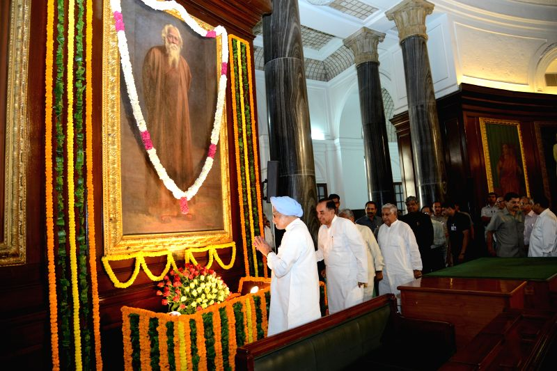 Prime Minister Manmohan Singh pays floral tribute to Rabindranath Tagore on Rabindra Jayanti (his birth anniversary) during a programme organised on 153 Rabindra Jayanti in the Parliament on on May .. - Manmohan Singh