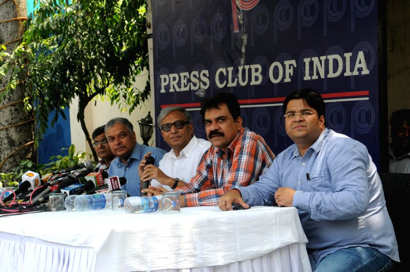Prime Minister Manmohan Singh's media advisor Pankaj Pachauri during a press conference at Press Club of India in New Delhi on April 18, 2014. - Manmohan Singh
