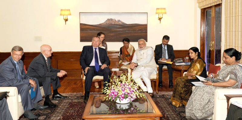 Prime Minister Narendra Modi (3 R), External Affairs Minister Sushma Swaraj (2 R) and Foreign Secretary Sujata Singh (R) during a meeting with  a Russian delegation led by Russian Deputy Prime ... - Sushma Swaraj and Secretary Sujata Singh