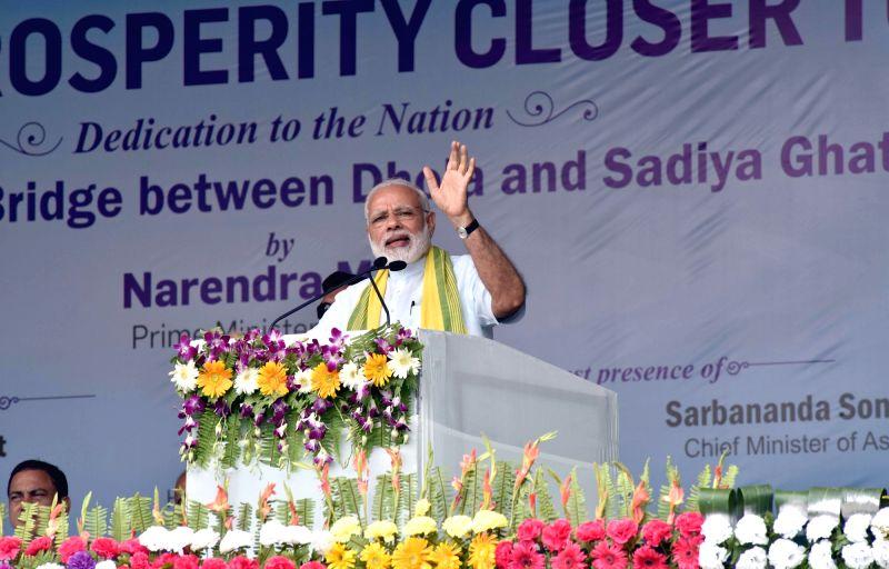 Prime Minister Narendra Modi addresses a public meeting after inaugurating Dhola-Sadia Bridge across Brahmaputra river, in Assam's Dibrugarh on May 26, 2017. - Narendra Modi