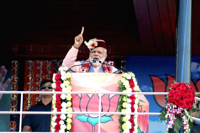 Prime Minister Narendra Modi addresses a rally at Ridge in Shimla on April 27, 2017. - Narendra Modi
