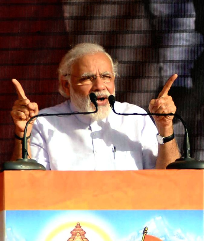 Prime Minister Narendra Modi addresses at a public rally in Davangere of Karnataka on May 29, 2016. - Narendra Modi