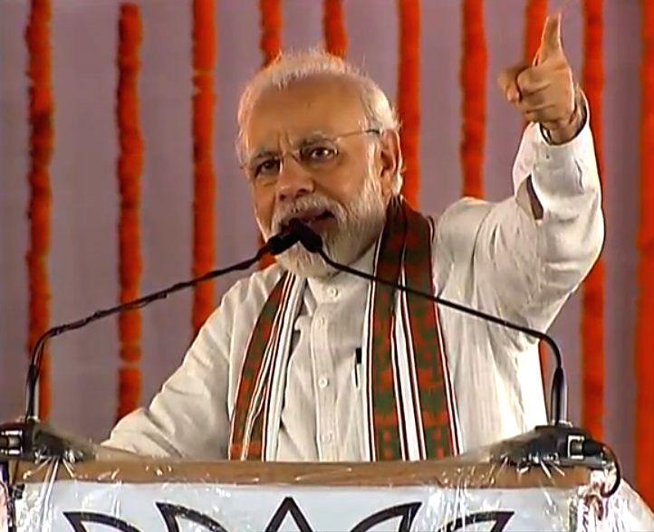 Prime Minister Narendra Modi addresses at a farmers rally in Uttar Pradesh's Shahjahanpur on July 21, 2018. - Narendra Modi