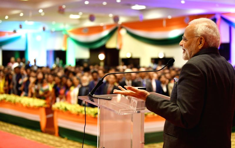 Prime Minister Narendra Modi addresses at a ceremonial reception accorded to him by the Indian Community, in Rwanda's Kigali on July 23, 2018. - Narendra Modi