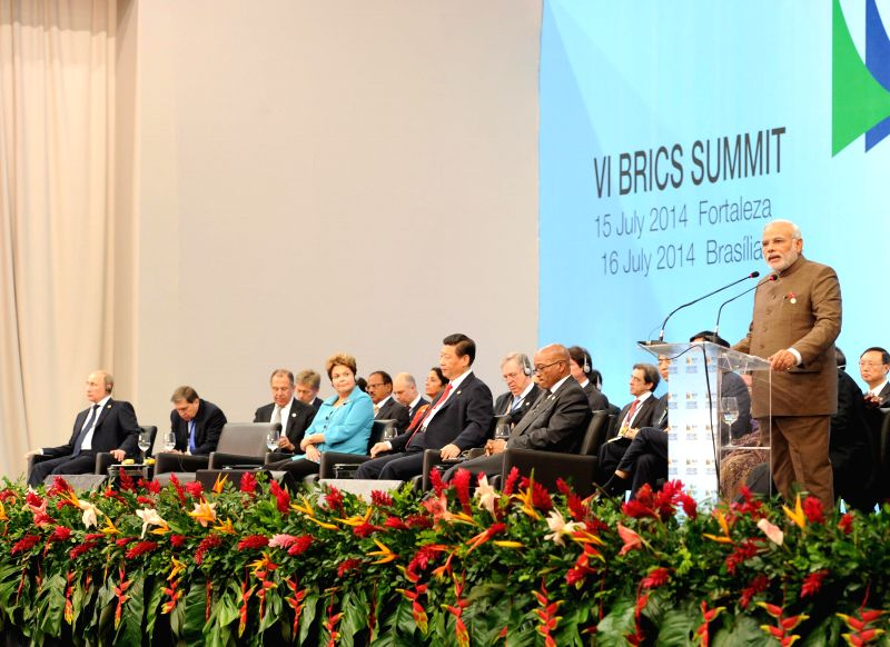 Prime Minister Narendra Modi addresses at the Plenary Session of the Sixth BRICS Summit at Ceara Events Centre in Fortaleza, Brazil on July 15, 2014. Also seen the President of Brazil Dilma Rousseff, - Narendra Modi