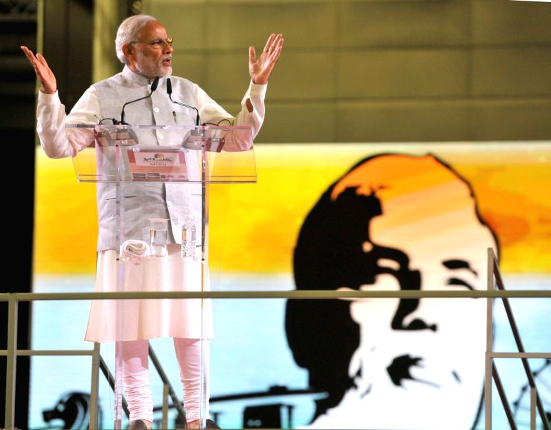 Prime Minister Narendra Modi addresses at the Indian Community reception event, at Singapore Expo, Singapore on Nov. 24, 2015. - Narendra Modi