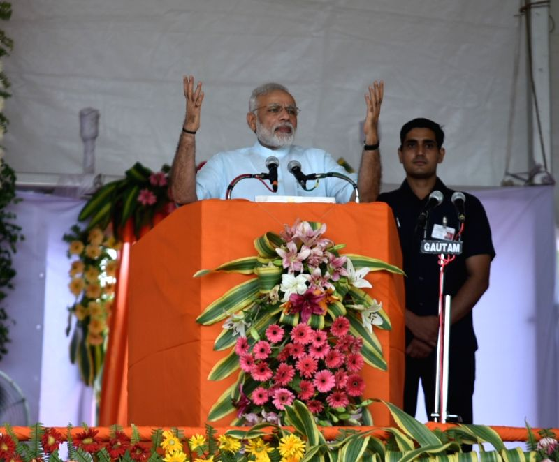 Prime Minister Narendra Modi addresses at the foundation stone laying ceremony of the AIIMS Gorakhpur and for the revival of Gorakhpur Fertilizer plant, at Sports Ground, FCI, in ... - Narendra Modi