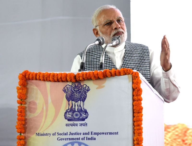 Prime Minister Narendra Modi addresses at the inauguration of the Dr. Ambedkar National Memorial at 26 Alipur Road, Delhi on April 13, 2018. - Narendra Modi