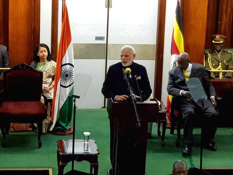 Prime Minister Narendra Modi addresses at the Ugandan Parliament, in Kampala on July 25, 2018. Also seen Uganda President Yoweri Kaguta Museveni. - Narendra Modi