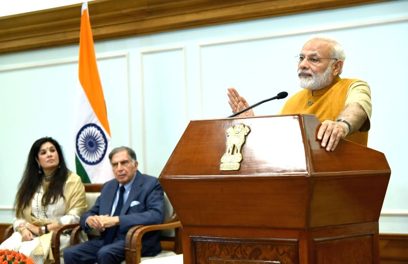 Prime Minister Narendra Modi addresses doctors and students of Tata Memorial Centre, via video conferencing, after releasing the Platinum Jubilee Milestone book on Tata Memorial Centre, in ... - Narendra Modi and Ratan Tata