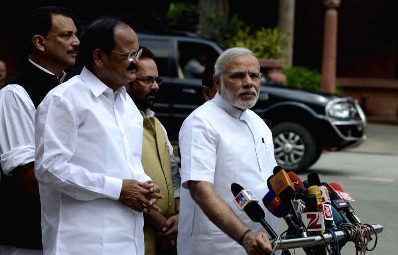 Prime Minister Narendra Modi addresses press at the Parliament in New Delhi, on July 21, 2015. Also seen the Union Minister for Urban Development, Housing and Urban Poverty Alleviation and ... - Narendra Modi and M. Venkaiah Naidu